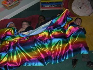 We had great fun role playing some of the positional language in the book. Here we are going under the cover!
