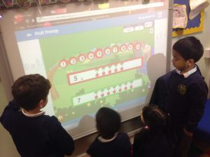 We used the interactive white board to play number games.