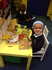 Using fine motor skills with Tap It Shapes.