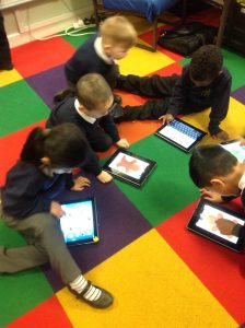 Busy designing Gingerbread Men using the ipads.