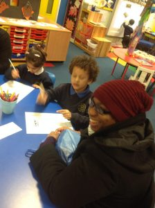 Working with parents to create a lost Gingerbread  Man poster.