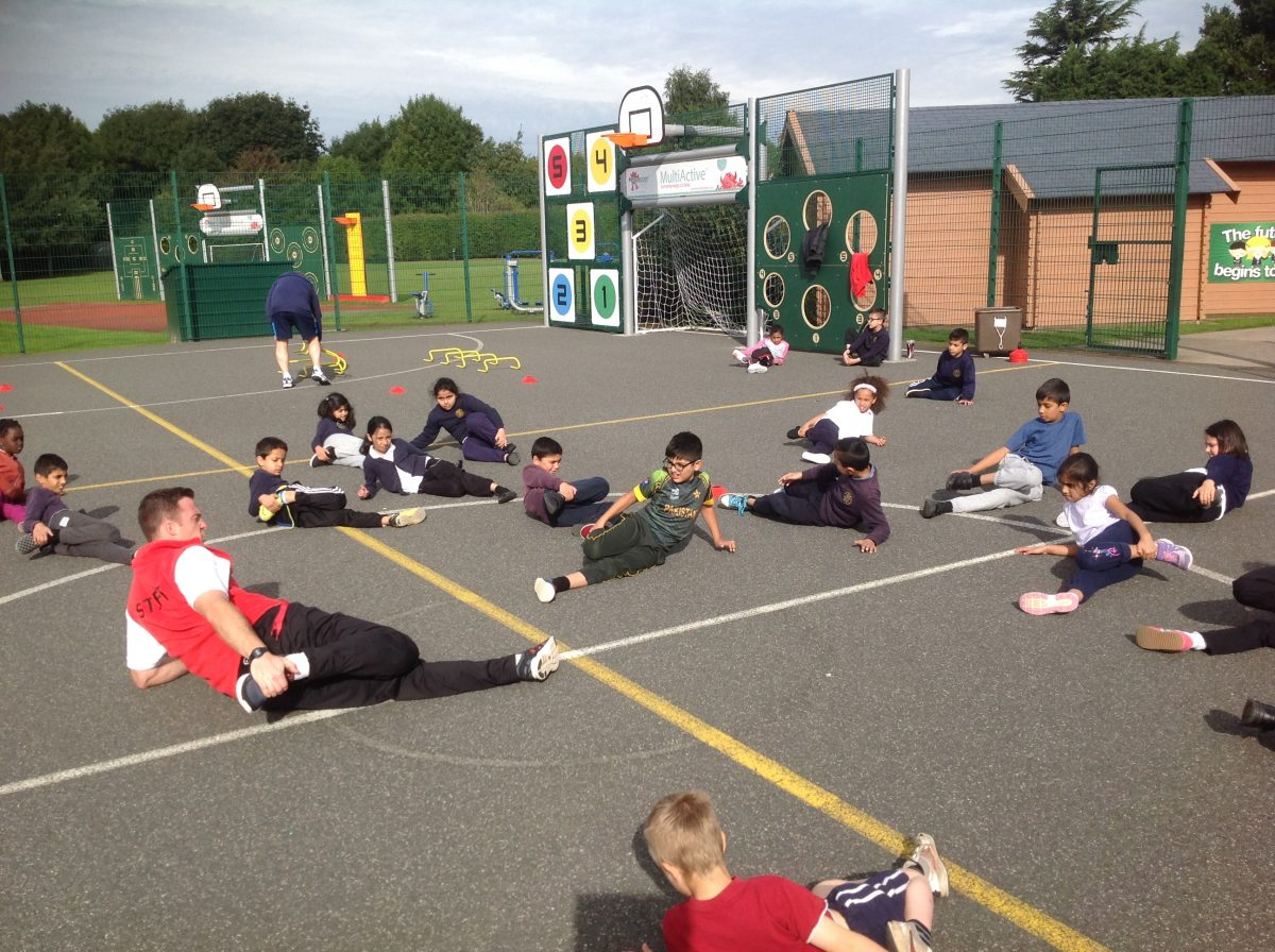 pupils setting good examples broad heath year 4 white stretch out mr burges in p e after working hard on