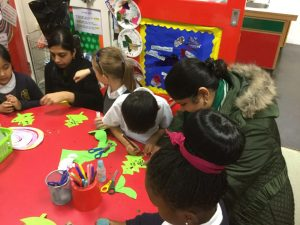 working together to create a wreath of holly.